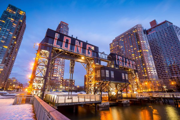 the buildings of long island in front of east river at twilight